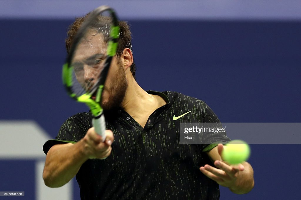 Jerzy Janowicz of Poland returns a shot to Novak Djokovic of Serbia Montenegro during his first round Men's Singles match on Day One of the 2016 US...