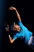 Jerzy Janowicz of Poland serves in his first round match against Jordan Thompson of Australia during day one of the 2014 Australian Open at Melbourne...