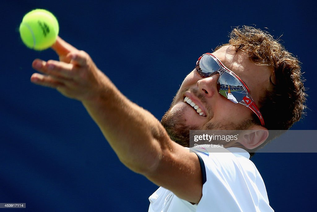 Jerzy Janowicz of Poland serves to David Goffin of Belguim during the men's quarterfinal match of the Winston-Salem Open at Wake Forest University on August 21, 2014 in Winston Salem, North Carolina.