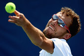 Jerzy Janowicz of Poland serves to David Goffin of Belguim during the men's quarterfinal match of the WinstonSalem Open at Wake Forest University on...