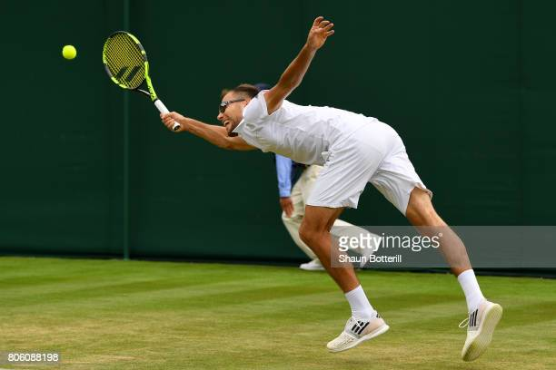 Jerzy Janowicz of Poland stretches to play a forehand during the Gentlemen's Singles first round match against Denis Shapovalov of Canada on day one...
