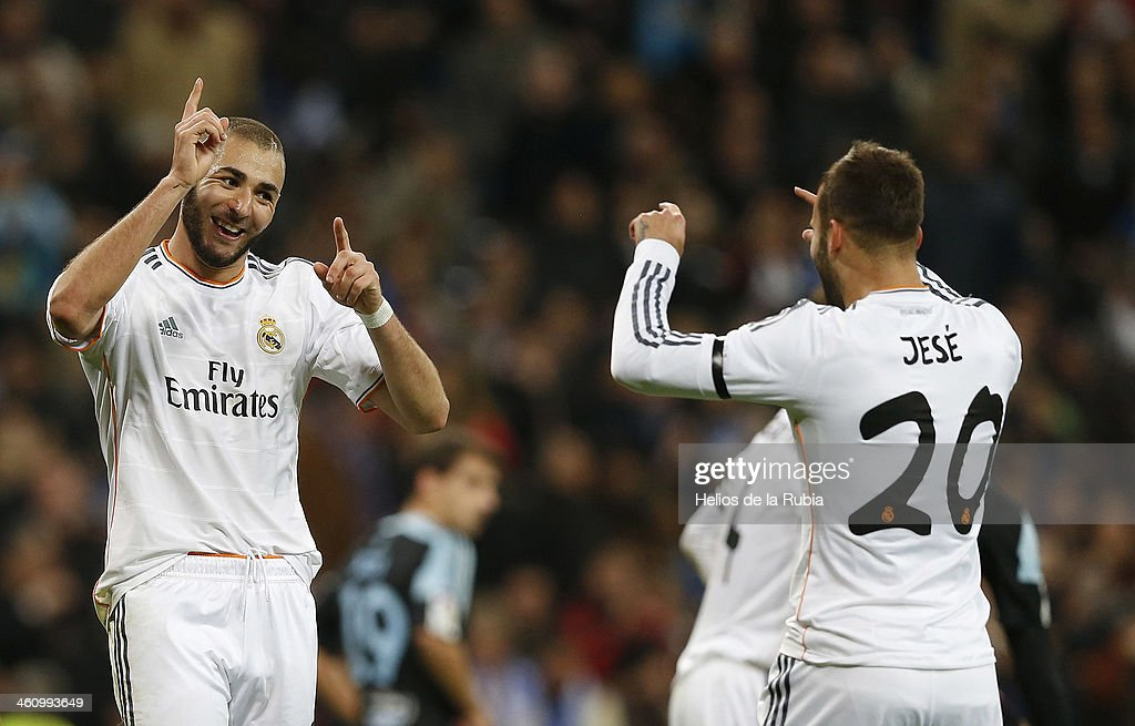 Jese (R) and <a gi-track='captionPersonalityLinkClicked' href=/galleries/search?phrase=Karim+Benzema&family=editorial&specificpeople=796089 ng-click='$event.stopPropagation()'>Karim Benzema</a> of Real Madrid celebrate after scoring during the La Liga match between Real Madrid and RC Celta de Vigo at Estadio Santiago Bernabeu on January 6, 2014 in Madrid, Spain.