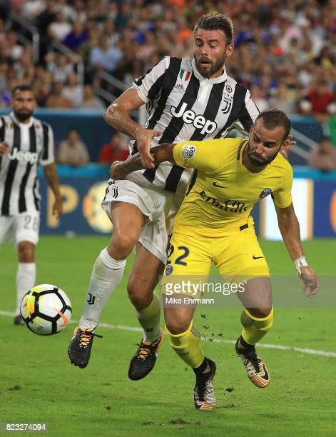 Jese of Paris SaintGermain and Neto of Juventus fight for the ball during the International Champions Cup 2017 match at Hard Rock Stadium on July 26...