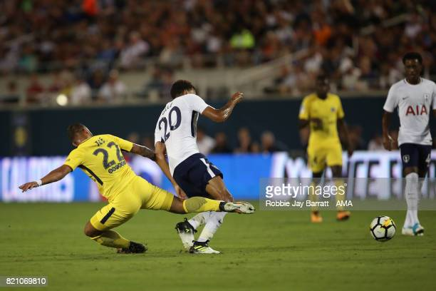 Jese of Paris SaintGermain with a late tackle on Dele Alli of Tottenham Hotspur during the International Champions Cup match between Paris...