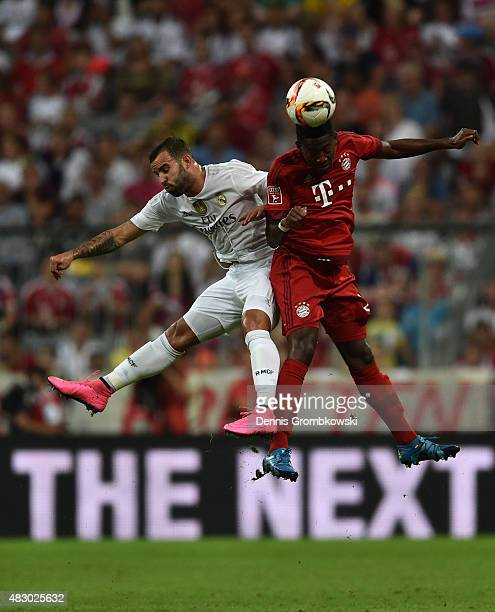 Jese of Real Madrid and David Alaba of FC Bayern Muenchen go up for a header during the Audi Cup 2015 Final between FC Bayern Muenchen and Real...