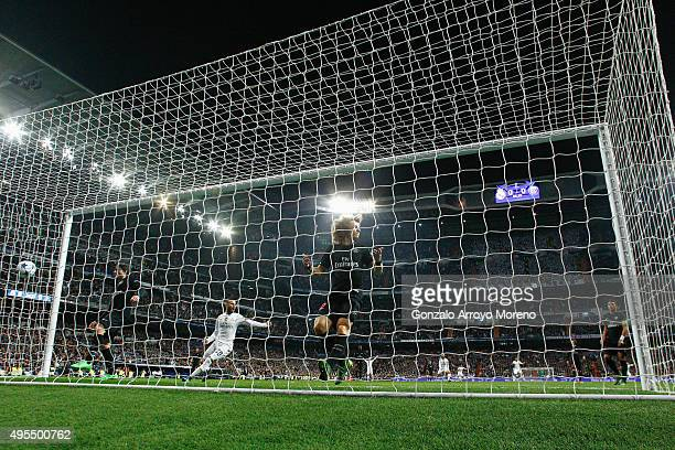 Jese of Real Madrid celebrates as David Luiz of PSG reacts as Nacho Fernandez of Real Madrid scores their first goal during the UEFA Champions League...