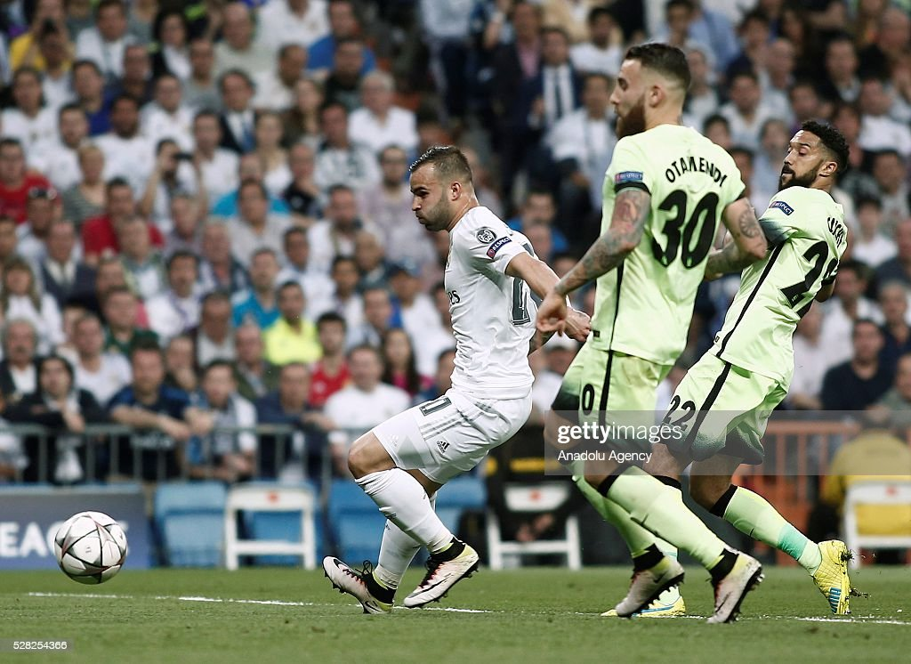 Jese (L) of Real Madrid in action against Nicolas Otamendi (C) of Manchester City during the UEFA Champions League semi-final second leg football match between Real Madrid and Manchester City at the Santiago Bernabeu Stadium in Madrid, Spain on May 4, 2016.