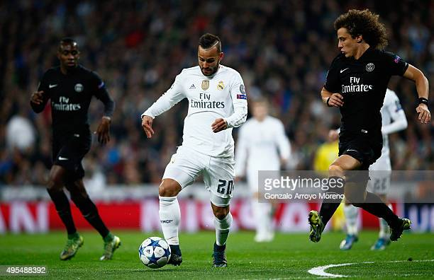 Jese of Real Madrid is watched by David Luiz of PSG during the UEFA Champions League Group A match between Real Madrid CF and Paris SaintGermain at...