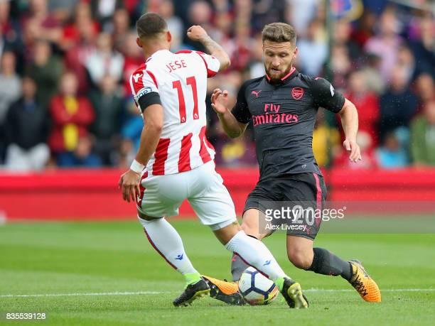 Jese of Stoke City and Shkodran Mustafi of Arsenal battle for possession during the Premier League match between Stoke City and Arsenal at Bet365...