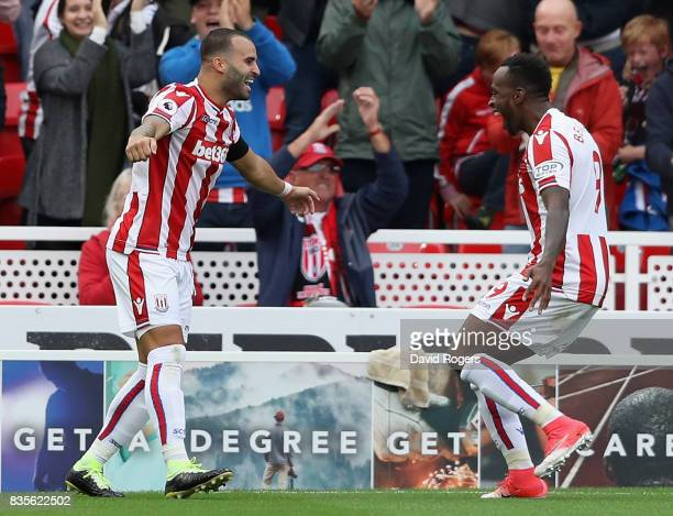 Jese of Stoke City celebrates with team mate Saido Berahino after scoring the winning goal during the Premier League match between Stoke City and...