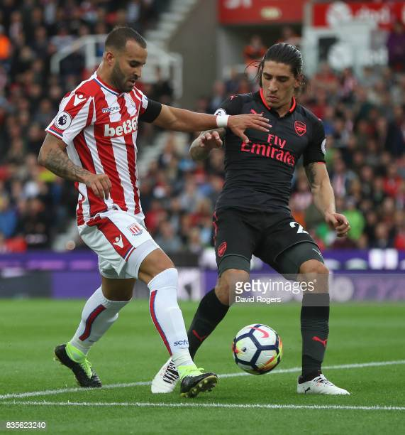 Jese of Stoke City is challenged by Hector Bellerin during the Premier League match between Stoke City and Arsenal at Bet365 Stadium on August 19...