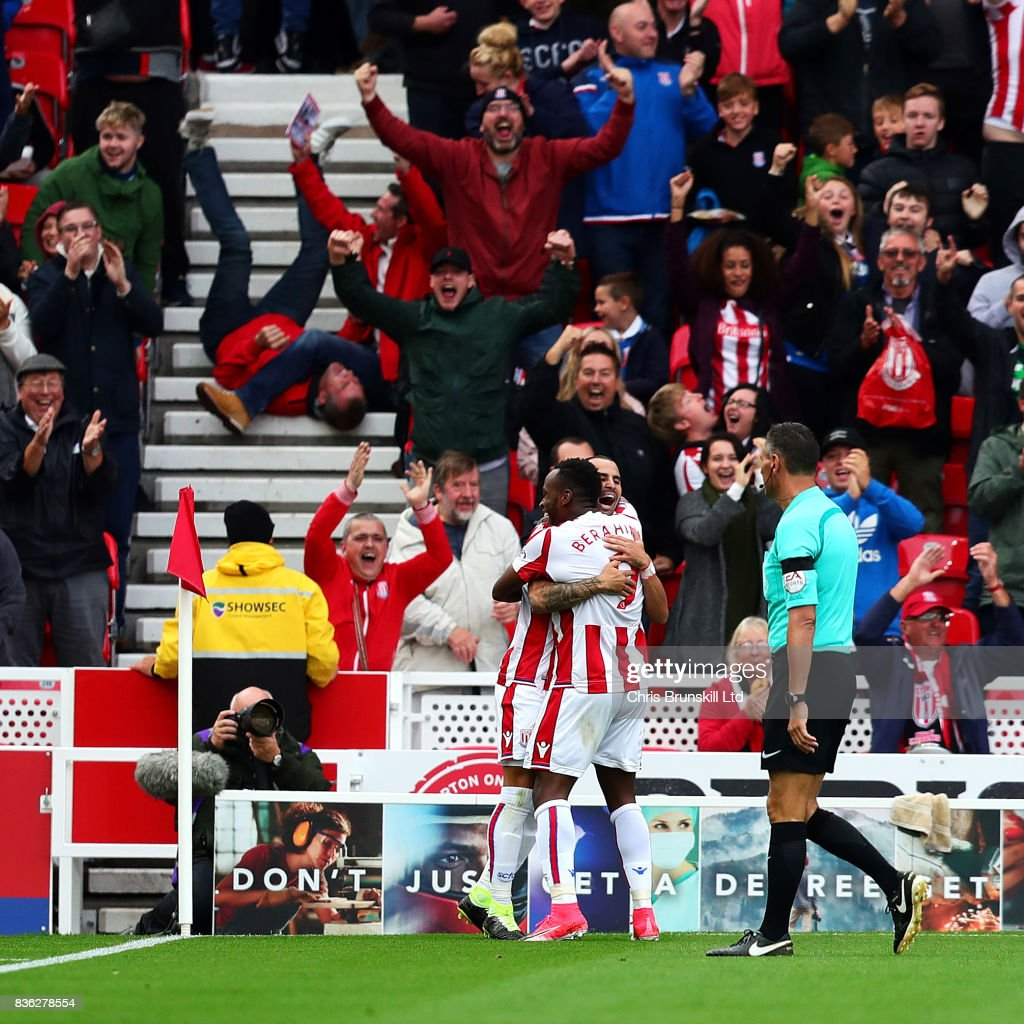Jese of Stoke City is congratulated by team-mate Saido Berahino after scoring the opening goal during the Premier League match between Stoke City and Arsenal at Bet365 Stadium on August 19, 2017 in Stoke on Trent, England.