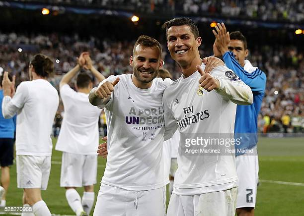 Jese Rodriguez and Cristiano Ronaldo of Real Madrid celebrate after the UEFA Champions League Semi Final second leg match between Real Madrid and...