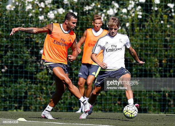 Jese Rodriguez and Martin Odegaard of Real Madrid in action during a training session at Valdebebas training ground on July 11 2015 in Madrid Spain