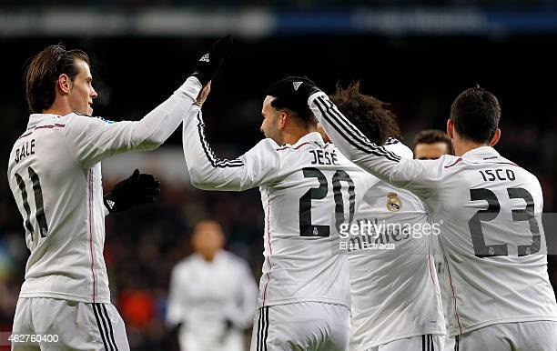 Jese Rodriguez of Real Madrid celebrates with Isco Alarcon and Gareth Bale during the La Liga match between Real Madrid CF and Sevilla FC at Estadio...