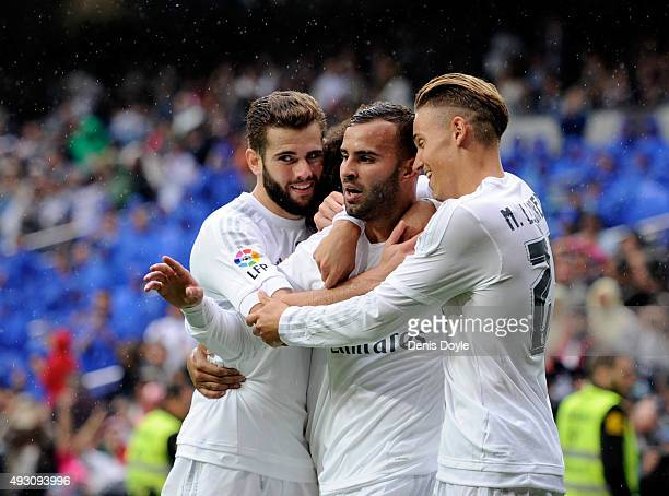 Jese Rodriguez of Real Madrid celebrates with Nacho and Marcos Llorente after scoring Real's 3rd goal during the La Liga match between Real Madrid CF...