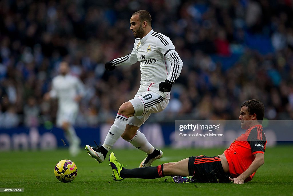 Jese Rodriguez of Real Madrid CF competes for the ball with Mikel Gonzalez Real Sociedad de Futbol during the La Liga match between Real Madrid CF...