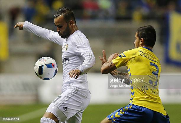 Jese Rodriguez of Real Madrid competes for the ball with Tomas Sanchez of Cadiz during the Copa del Rey round of 32 first leg match between Cadiz and...