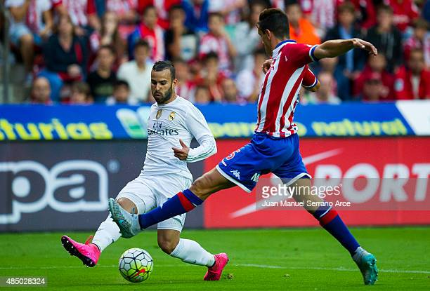 Jese Rodriguez of Real Madrid duels for the ball with Bernardo Espinosa of Real Sporting de Gijon during the La Liga match between Sporting Gijon and...
