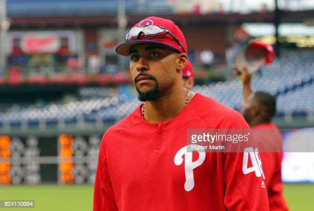 Jesen Therrien of the Philadelphia Phillies walks in from shagging fly balls in the outfield during batting practice before a game against the...