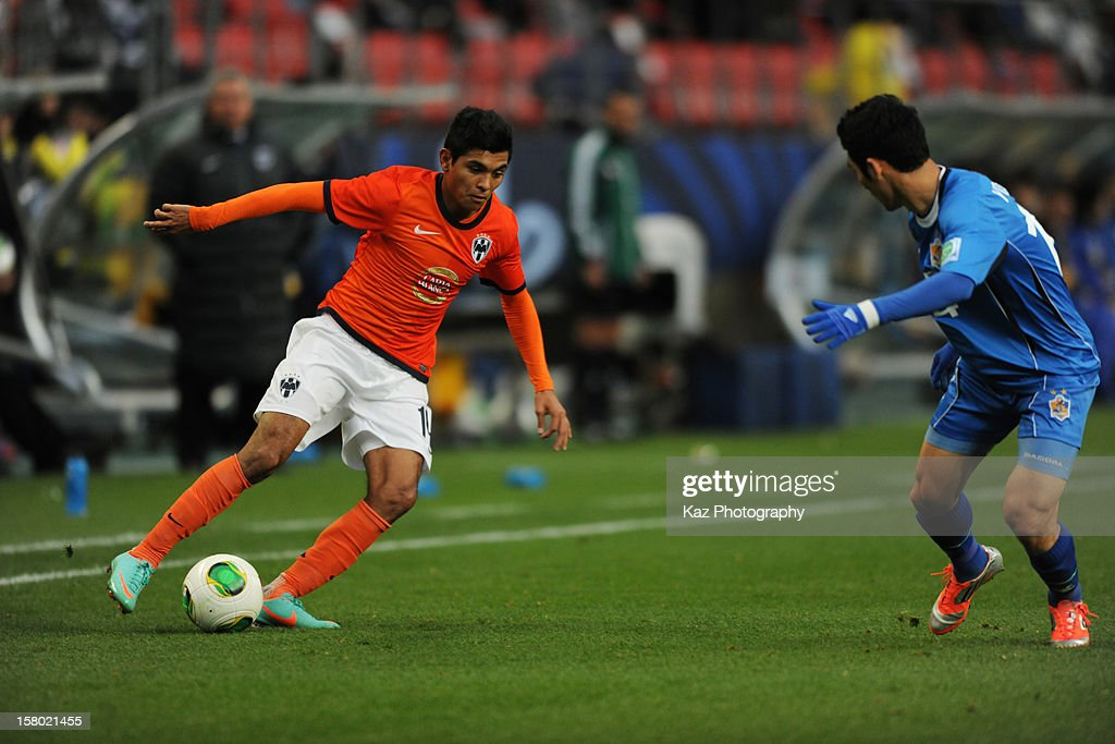 Jeses Corona of CF Monterrey keeps the ball under the pressure from Youngsam Kim of Ulsan Hyundai during the FIFA Club World Cup Quarter Final match between Ulsan Hyundai and CF Monterrey at Toyota Stadium on December 9, 2012 in Toyota, Japan.