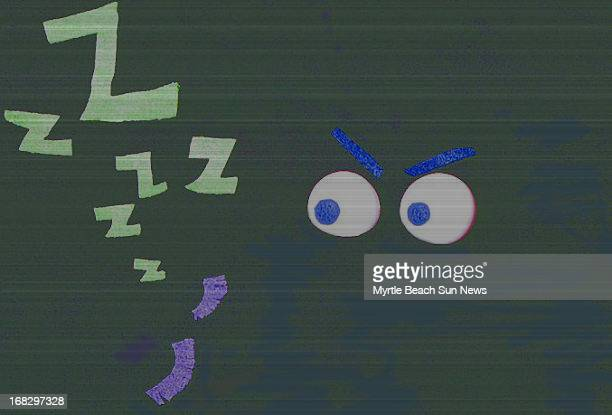 Jesi Kane color illustration Dark background with two eyes looking at green Zs The Sun News /MCT via Getty Images