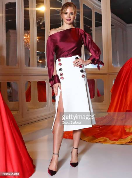 Jesinta Franklin David Jones Ambassador poses among dresses on display during a media preview of The House of Dior Seventy Years of Haute Couture...