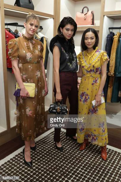Jesinta Franklin Hikari Mori and Yoyo Cao attends the Coach InStore Event with Selena Gomez at Coach Boutique on September 13 2017 in New York City