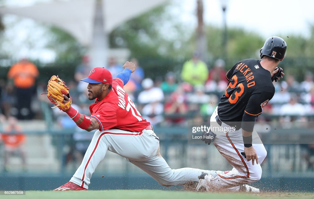 Jesmuel Valentin #76 of the Philadelphia Phillies makes the stretch to force the out on Joey Rickard #23 of the Baltimore Orioles during the sixth inning of thed Spring Training Game on March 13, 2017 at Ed Smith Stadium in Sarasota, Florida. Baltimore defeated Philadelphia 6-4.