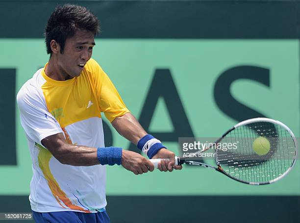 Jeson Patrombon of the Philippines hits a return against Indonesia's Christopher Rungkat during the final round of the men's Davis Cup AsiaOceania...