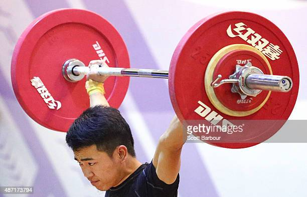 Jesos Ronny of Malaysia lifts during the Men 56kg A Weightlifting at the Tuanaimato Sports Facility on day one of the Samoa 2015 Commonwealth Youth...