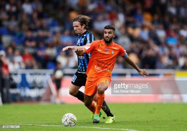 Jesper Arvidsson of IK Sirius FK and Omar Eddahri of Athletic FC Eskilstuna competes for the ball during the Allsvenskan match between IK Sirius FK...