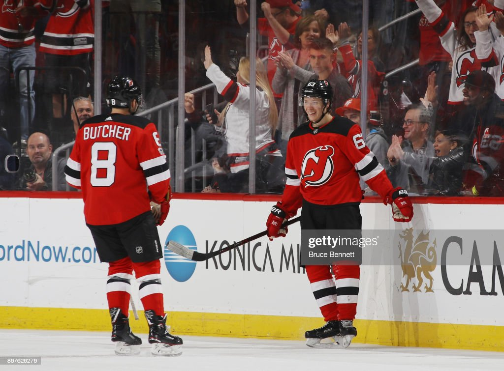 Jesper Bratt #63 of the New Jersey Devils (r) celebrates his game winning powerplay goal at 15:47 of the third period against the Arizona Coyotes and is joined by Will Butcher #8 (l) at the Prudential Center on October 28, 2017 in Newark, New Jersey. The Devils defeated the Coyotes 4-3.