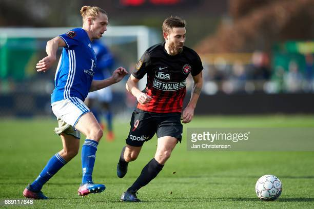 Jesper Christjansen of Lyngby BK and Janus Drachmann of FC Midtjylland compete for the ball during the Danish Alka Superliga match between Lyngby BK...