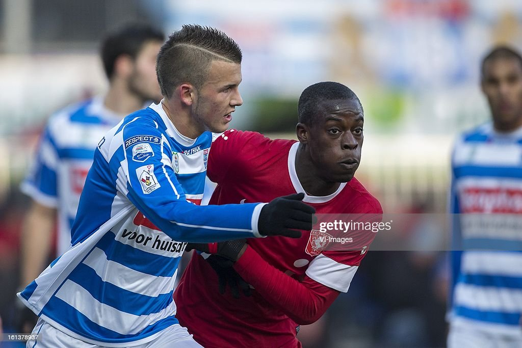 Jesper Drost of PEC Zwolle, Edwin Gyasi of FC Twente during the Dutch Eredivisie match between PEC Zwolle and FC Twente at the IJsseldelta Stadium on february 10, 2013 in Zwolle, The Netherlands