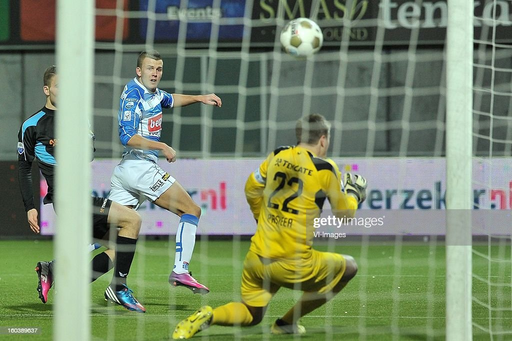 Jesper Drost of PEC Zwolle, goalkeeper Remko Pasveer of Heracles Almelo during the Dutch Cup match between PEC Zwolle and Heracles Almelo at the IJsseldelta Stadium on january 30, 2013 in Zwolle, The Netherlands
