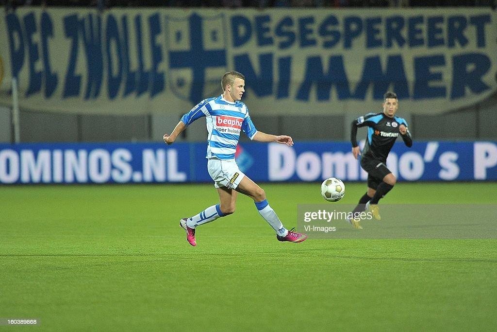 Jesper Drost of PEC Zwolle, Ninos Gouriye of Heracles Almelo during the Dutch Cup match between PEC Zwolle and Heracles Almelo at the IJsseldelta Stadium on january 30, 2013 in Zwolle, The Netherlands