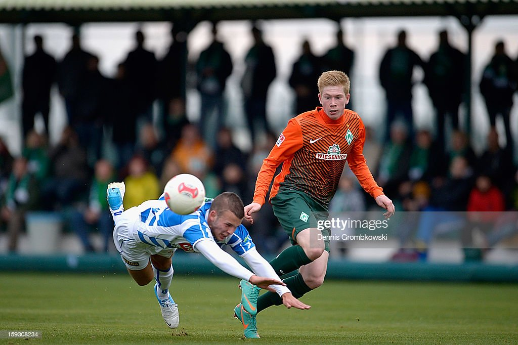 Jesper Drost of Zwolle is challenged by Kevin de Bruyne of Bremen during a friendly match between Werder Bremen and PEC Zwolle on January 11 2013 in...