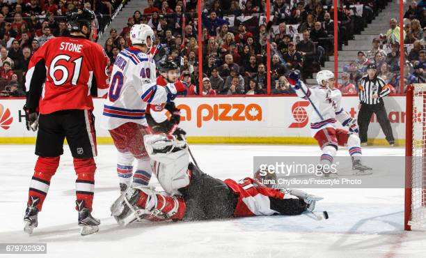 Jesper Fast of the New York Rangers celebrates his first period goal as Craig Anderson of the Ottawa Senators lies on the ice and Mark Stone of the...