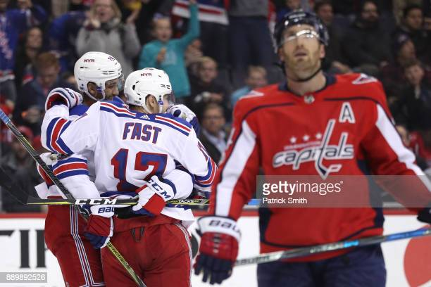 Jesper Fast of the New York Rangers celebrates with teammates after scoring a goal against the Washington Capitals during the third period at Capital...