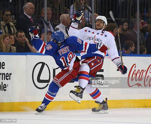Jesper Fast of the New York Rangers collides with Alex Ovechkin of the Washington Capitals during the third period in Game Five of the Eastern...