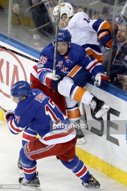 Jesper Fast of the New York Rangers collides with Thomas Hickey of the New York Islanders in the fist period during their game at Madison Square...