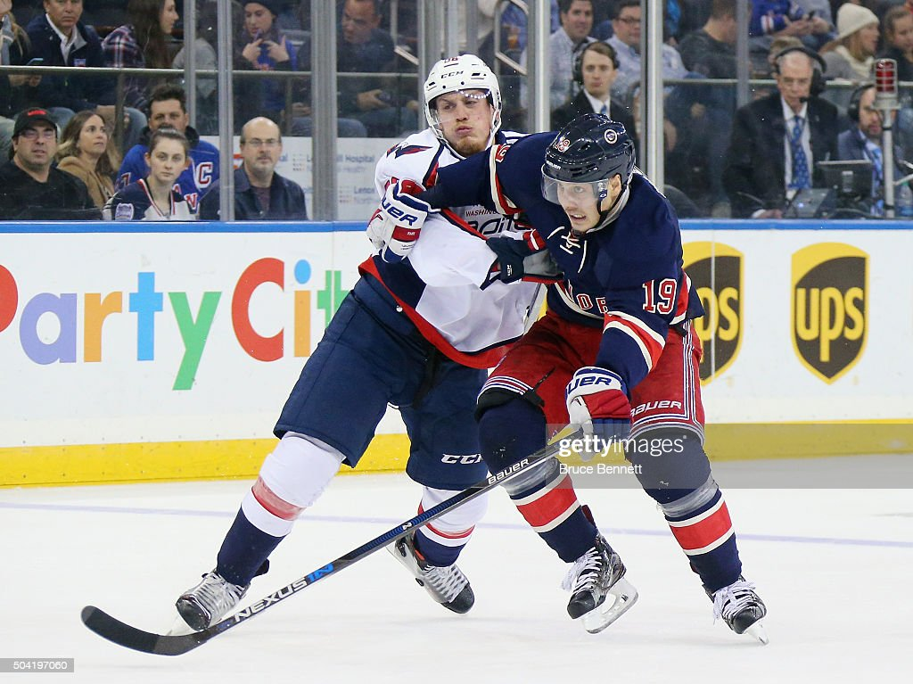 Jesper Fast of the New York Rangers is checked by Nate Schmidt of the Washington Capitals at Madison Square Garden on January 9 2016 in New York City...
