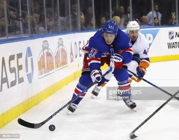 Jesper Fast of the New York Rangers skates against the New York Islanders at Madison Square Garden on October 19 2017 in New York City The Islanders...