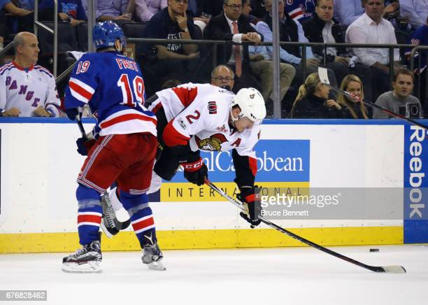 Jesper Fast of the New York Rangers trips up Dion Phaneuf of the Ottawa Senators in Game Three of the Eastern Conference Second Round during the 2017...