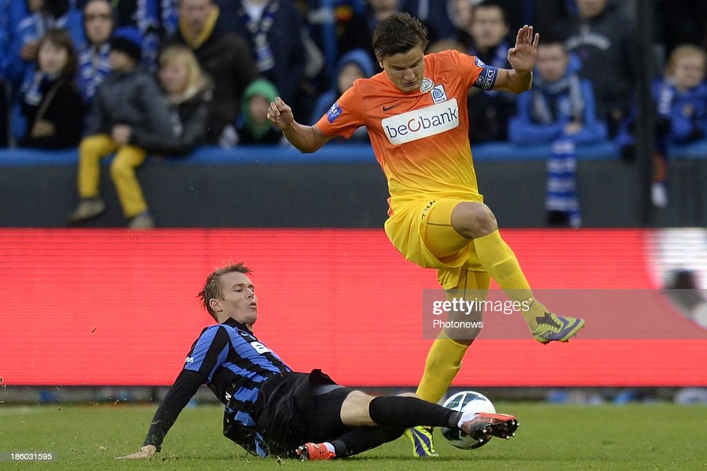 Jesper Jorgensen of Club Brugge battles for the ball with Jelle Vossen of KRC Genk during the Jupiler Pro League match between Club Brugge KV and KRC Genk on October 27, 2013 in Brugge, Belgium.