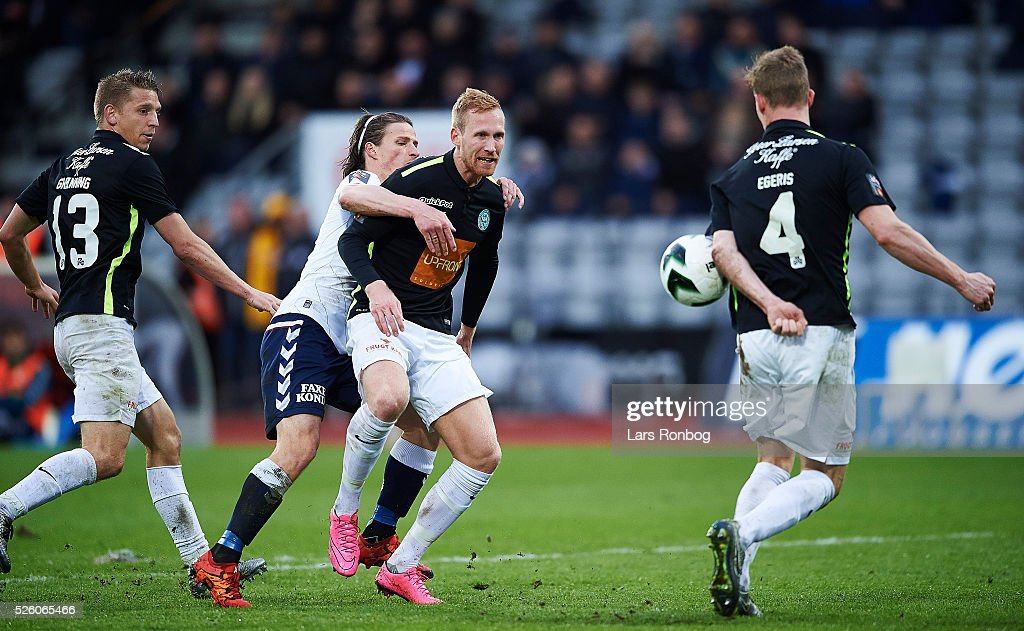 Jesper Lange of AGF Aarhus and Jonas Thorsen of Viborg FF compete for the ball while it hits Jacob Egeris of Viborg FF in his arm during the Danish Alka Superliga match between AGF Aarhus and Viborg FF at Ceres Park on April 29, 2016 in Aarhus, Denmark.