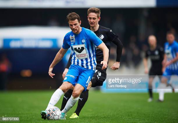 Jesper Lauridsen of Esbjerg fB and Andreas Bruhn of Randers FC compete for the ball during the Danish Alka Superliga match between Esbjerg fB and...