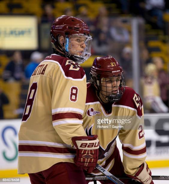 Jesper Mattila of the Boston College Eagles and teammate Graham McPhee get ready for a faceoff during NCAA hockey against the Boston University...