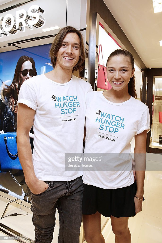 Jesper Mcilroy and Cara G attend Michael Kors World Food Day - Hong Kong on October 16, 2013.